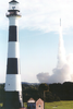 Lighthouse with Atlas III Launch